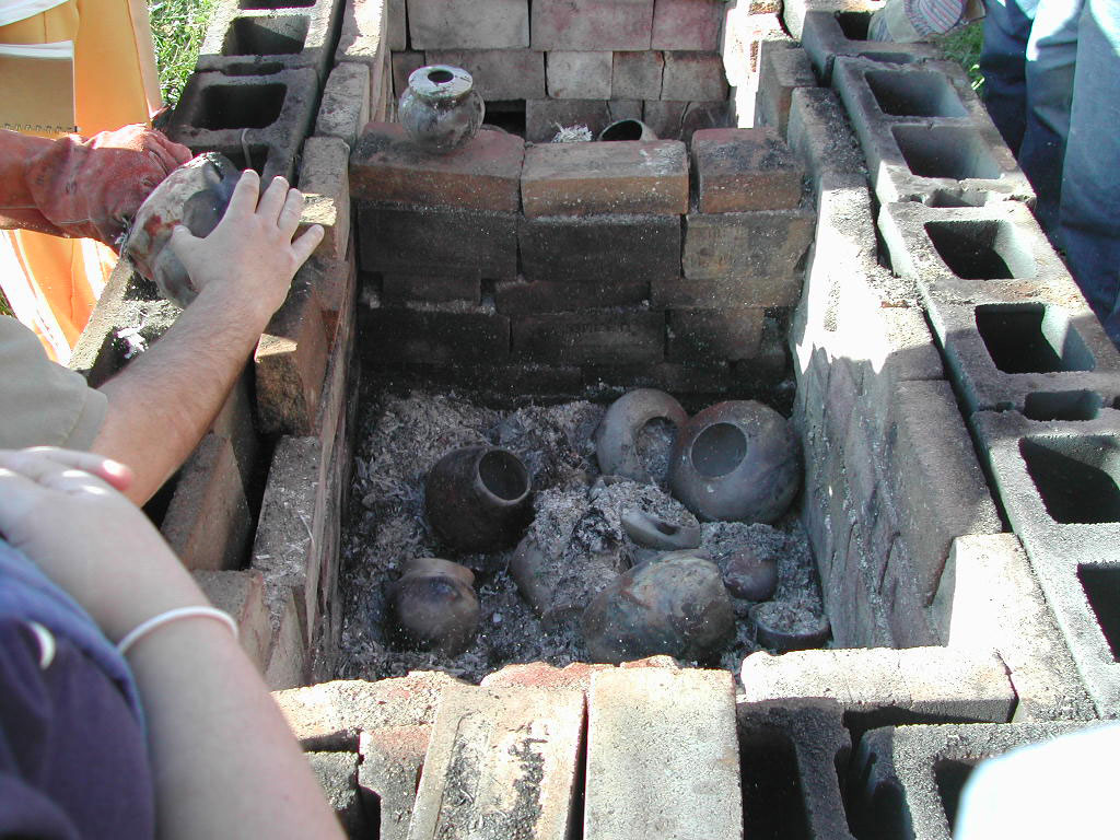 Unpacking the pit after the firing